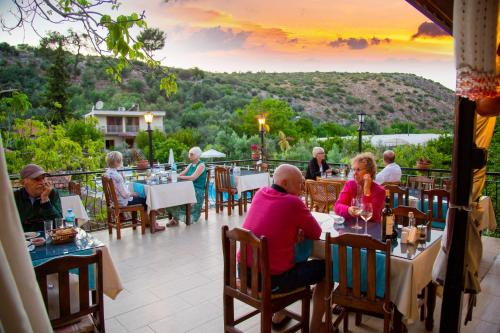 A restaurant or other place to eat at Flower Hotel Patara