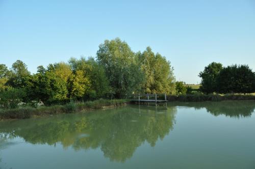 The swimming pool at or near La ferme d'aristide