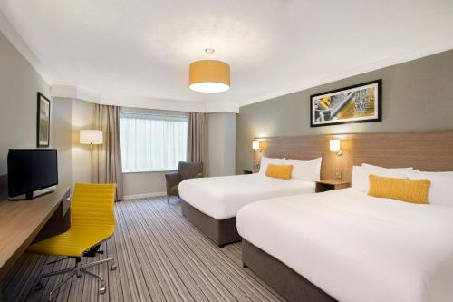 A bed or beds in a room at Jurys Inn Hinckley Island