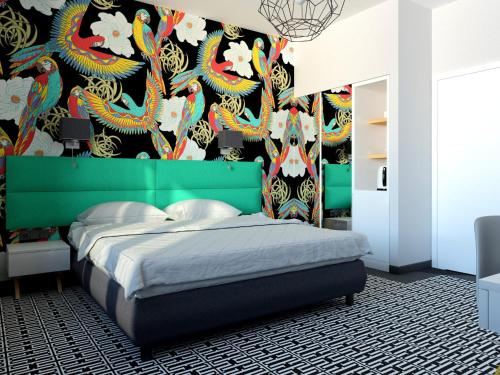 A bed or beds in a room at Liv'Inn Aparthotel