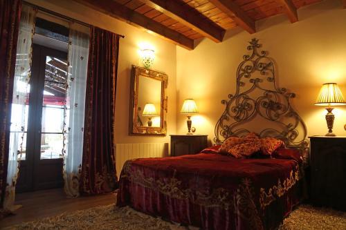 Cama o camas de una habitación en La Posada Del Canal