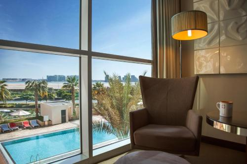 A view of the pool at Centro Yas Island-by Rotana or nearby