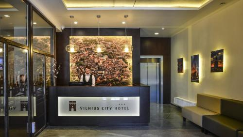 The lobby or reception area at Vilnius City Hotel