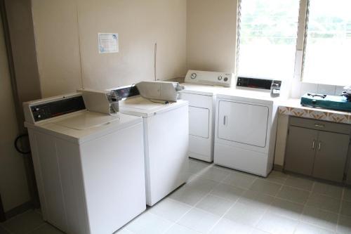 A kitchen or kitchenette at DW Motel