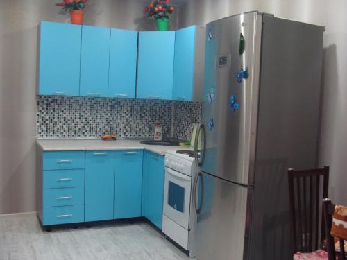 Кухня или мини-кухня в Apartments 30 micro-district, 9
