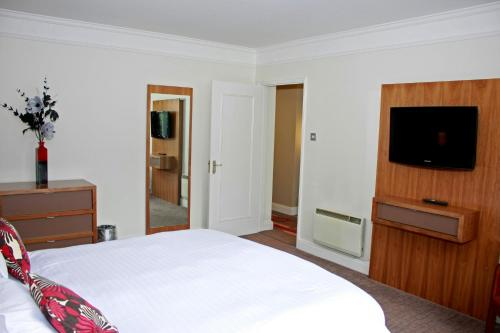 A bed or beds in a room at Bromsgrove Hotel and Spa