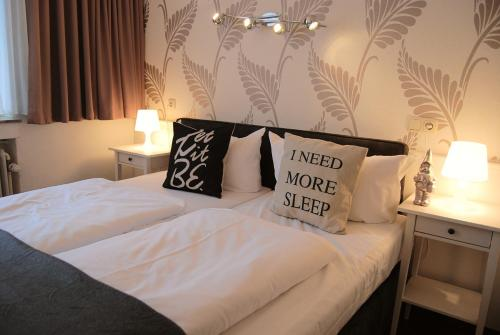 A bed or beds in a room at Hotel Krone Aachen | City-Eurogress