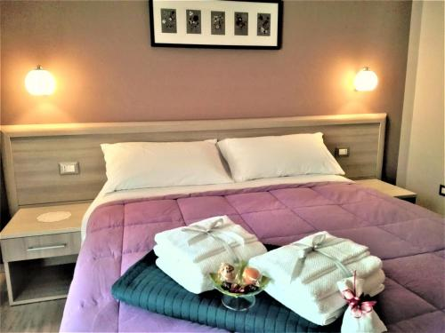 A bed or beds in a room at B&B Giano