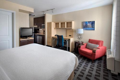 A television and/or entertainment center at TownePlace Suites Republic Airport Long Island Farmingdale