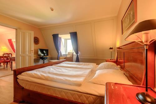 En eller flere senge i et værelse på Zleep Hotel Prindsen Roskilde