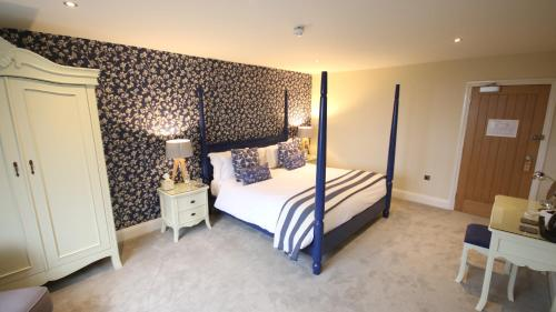 A bed or beds in a room at The Malvern Hills Hotel