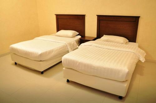 Cama ou camas em um quarto em Marahal Al Rawabi