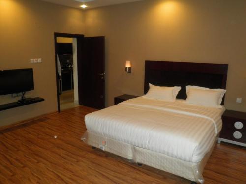 Cama ou camas em um quarto em Marahal kharj
