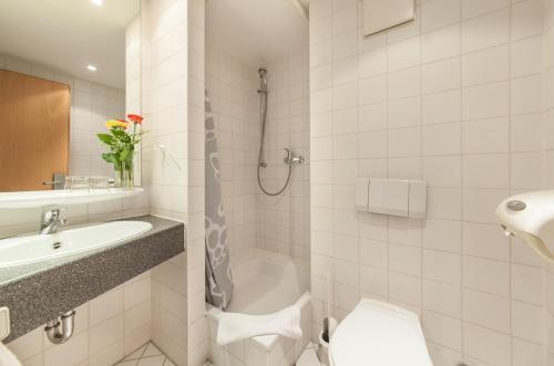 Ein Badezimmer in der Unterkunft Novum Hotel Seegraben Cottbus