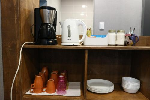 Coffee and tea-making facilities at Zzzip Guesthouse in Hongdae