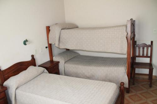 A bunk bed or bunk beds in a room at Cabo Vírgenes