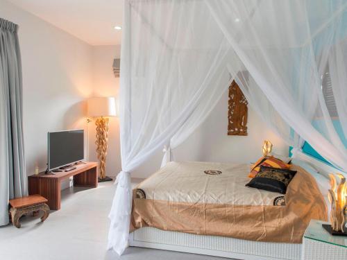 En eller flere senge i et værelse på Moon Cottage