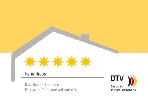 Das Logo oder Schild des Ferienhauses