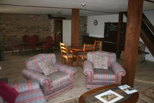 A seating area at Le Prestige Bed & Breakfast