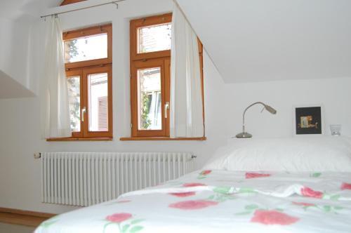 Ein Bett oder Betten in einem Zimmer der Unterkunft Geigenbauer-Häuschen