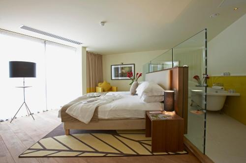 A bed or beds in a room at ABode Chester