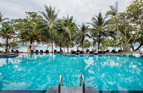 Der Swimmingpool an oder in der Nähe von Impiana Resort Patong, Phuket - SHA Plus