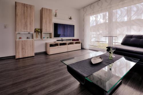Ein Sitzbereich in der Unterkunft Ferienwohnung im Bockrieß
