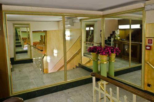 The lobby or reception area at Hotel Brignole