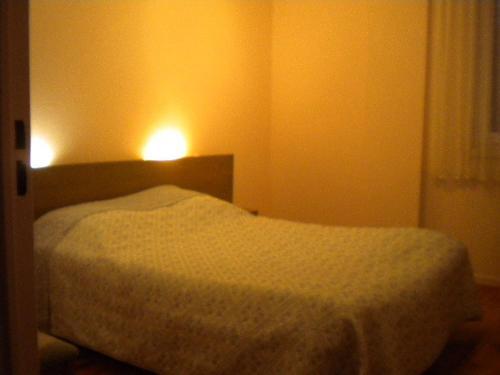 Кровать или кровати в номере Contact Hotel Du Ladhof
