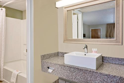 A bathroom at Super 8 by Wyndham Denver Central