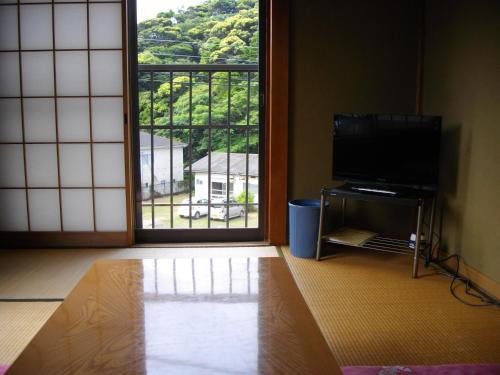 A television and/or entertainment center at Minshuku Haji