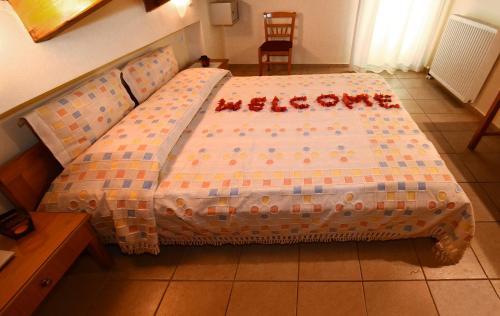 Ένα ή περισσότερα κρεβάτια σε δωμάτιο στο Brati II Beach