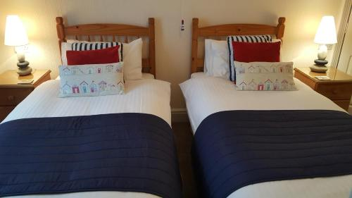A bed or beds in a room at Tregonwell House - Guest House