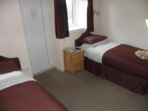 A bed or beds in a room at Morefield Motel