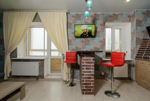Телевизор и/или развлекательный центр в Апартаменты Космос на Морозова