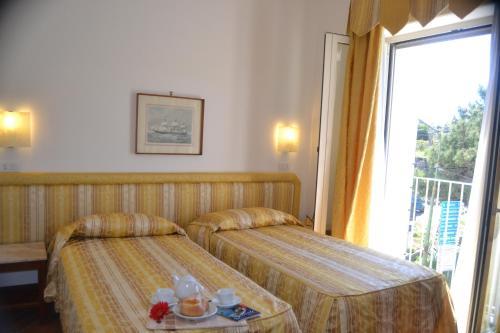Letto o letti in una camera di Hotel Royal Hills