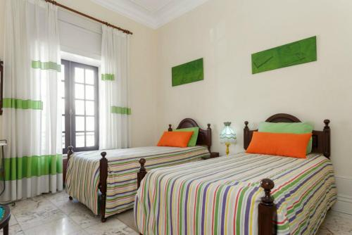 A bed or beds in a room at 18St. Hostel