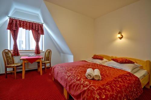 Łóżko lub łóżka w pokoju w obiekcie Pod Tatrami Białka Centrum
