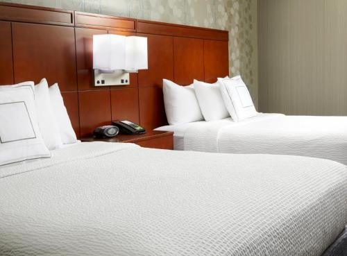 A bed or beds in a room at Courtyard by Marriott San Antonio Six Flags at The RIM