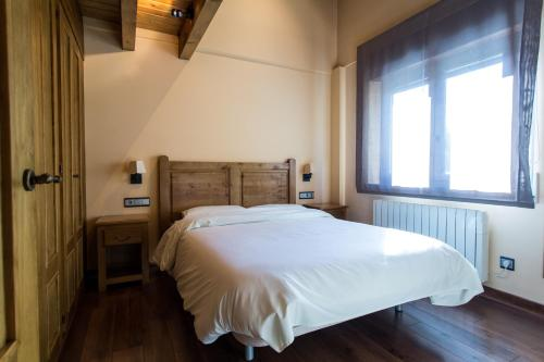 A bed or beds in a room at Apartaments Gran Vall