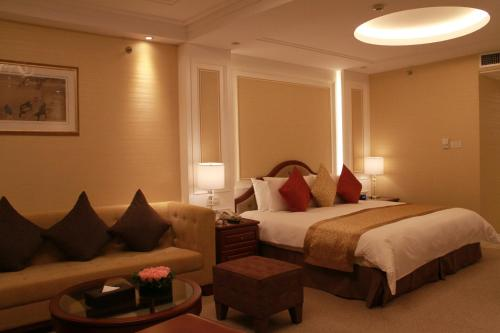 A bed or beds in a room at Central Hotel Shanghai