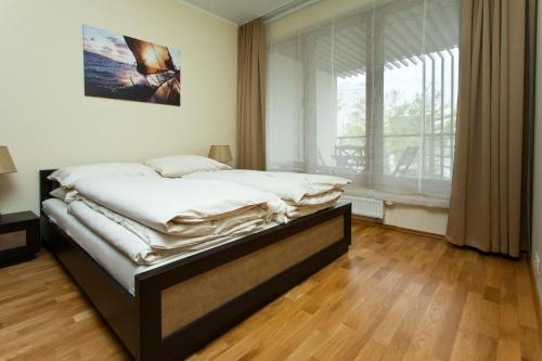 Łóżko lub łóżka w pokoju w obiekcie Apartamenty Olimpic