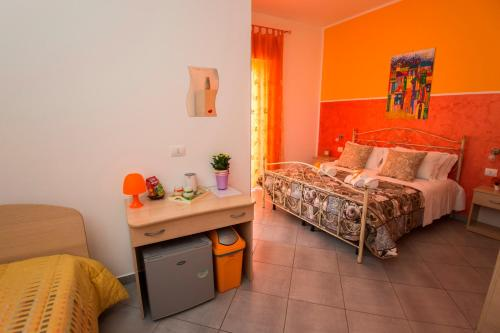Letto o letti in una camera di L'angolo di Laura Comfortable Rooms