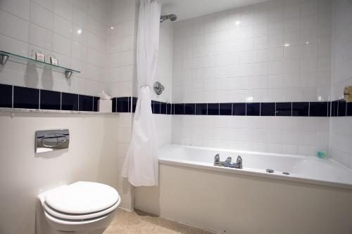 A bathroom at The Metropole Hotel