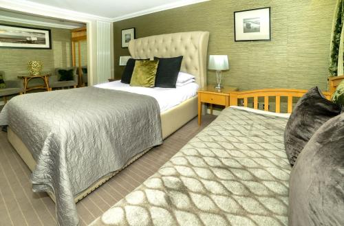 A bed or beds in a room at Stradey Park Hotel and Spa