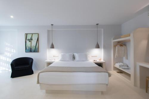 A bed or beds in a room at Finikas Hotel
