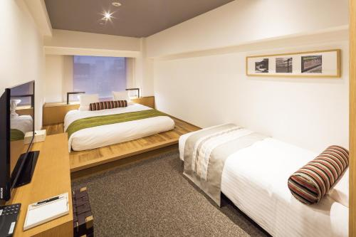 A bed or beds in a room at HOTEL MYSTAYS PREMIER Omori