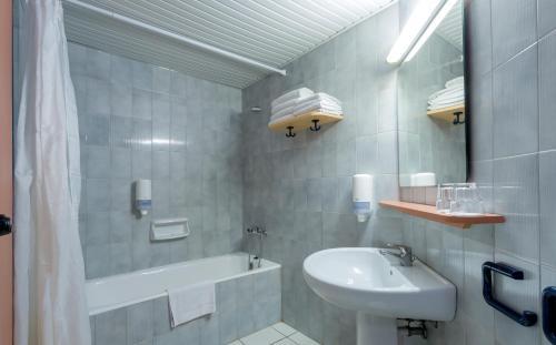A bathroom at Dessole Dolphin Bay - All Inclusive