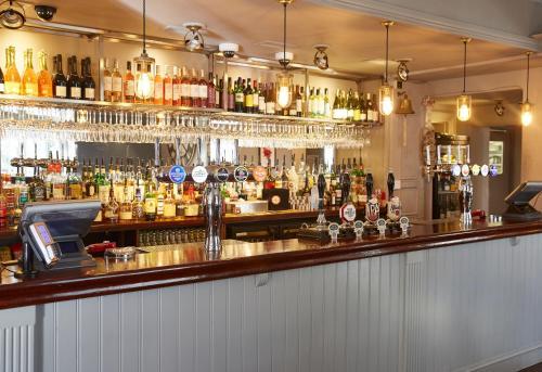 The lounge or bar area at Cedars Inn by Greene King Inns