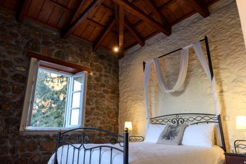 Ένα ή περισσότερα κρεβάτια σε δωμάτιο στο Ξενώνας Νηρηίδες